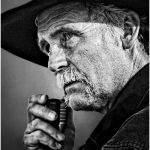 Rodeo Announcer by Cliff Lawson, f16 B&W Digital, Score: 9